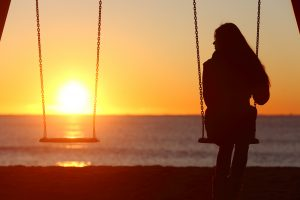 Single Woman Alone Swinging | Depression Treatment & Counseling | Greenville, SC 29615